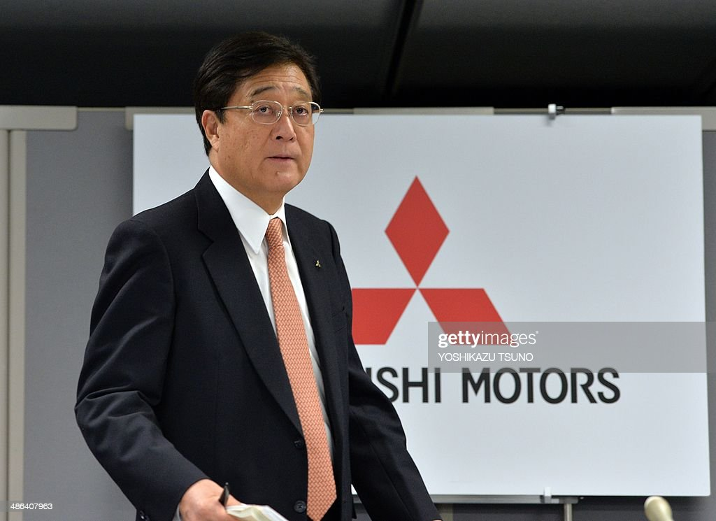 Japan's auto maker Mitsubishi Motors president Osamu Masuko arrives at a conference room to announce the company's financial result ended March at...