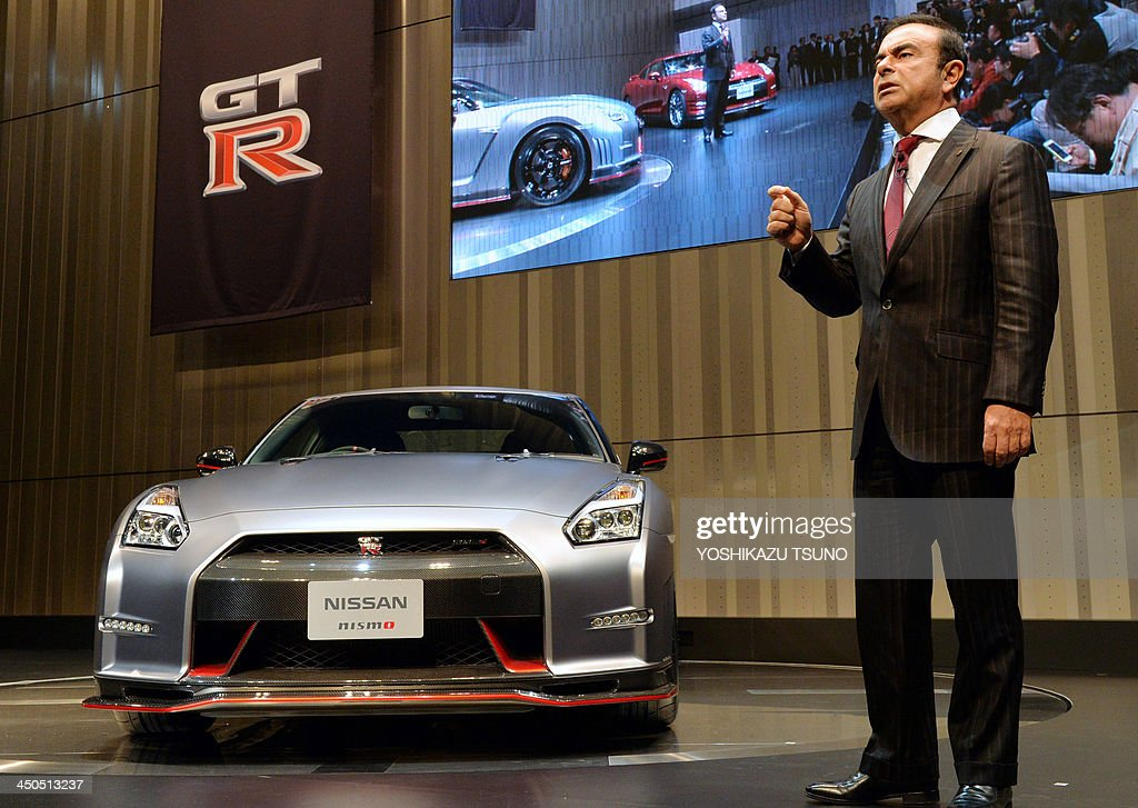 Japan's auto maker Nissan Motor's president Carlos Ghosn introduces the new flagship sports car 'GT-R' at the company's headquarters in Yokohama, suburban Tokyo on November 19, 2013. The vehicle was introduced ahead of the Tokyo Motor Show which begins November 20. AFP PHOTO / Yoshikazu TSUNO