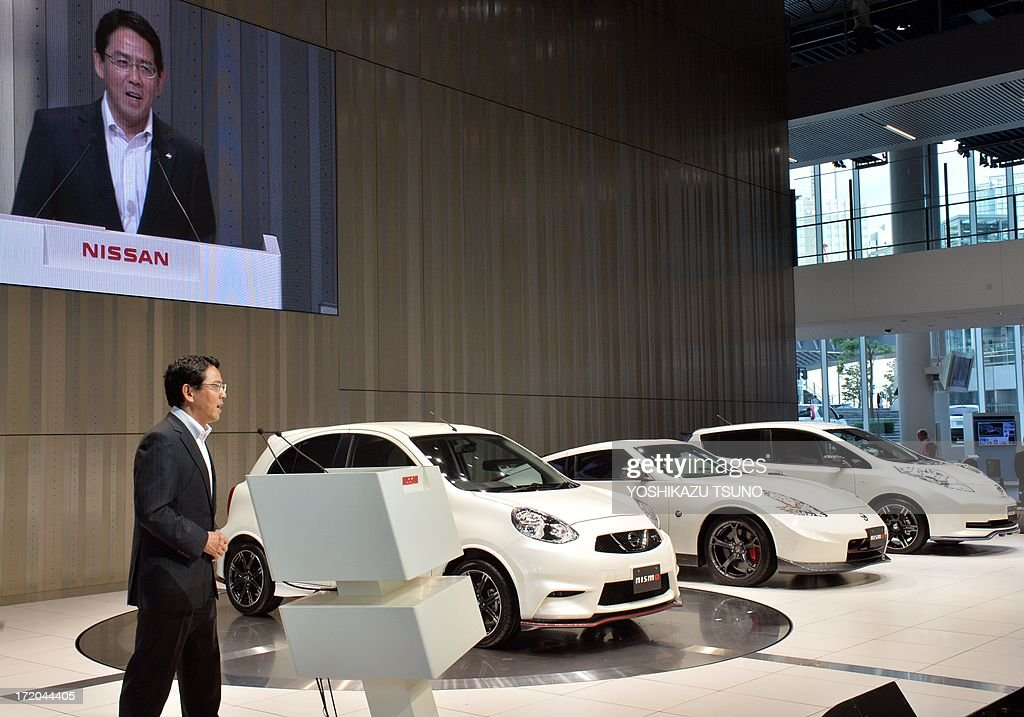 Japan's auto maker Nissan Motor's subsidiary and tuning factory Nismo president Syoichi Miyatani introduces the company's tune-up cars (L-R) March Nismo, Fairlady Z Nismo and Leaf Nismo at Nissan's headquarters in Tokyo on July 1, 2013. Fairlady Z Nismo (370Z Nismo) with a 3.7-litter powerful engine will go on sale this month, while the March Nismo (Micra Nismo) will be on the market end of this year. AFP PHOTO / Yoshikazu TSUNO