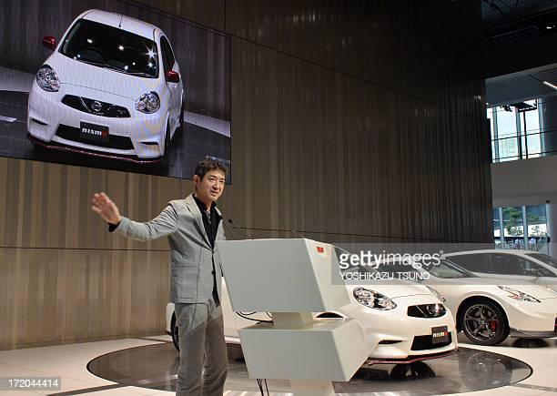 Japan's auto maker Nissan Motor's subsidiary and tuning factory Nismo president engineer Hiroshi Tamura introduces the company's tuneup car 'March...