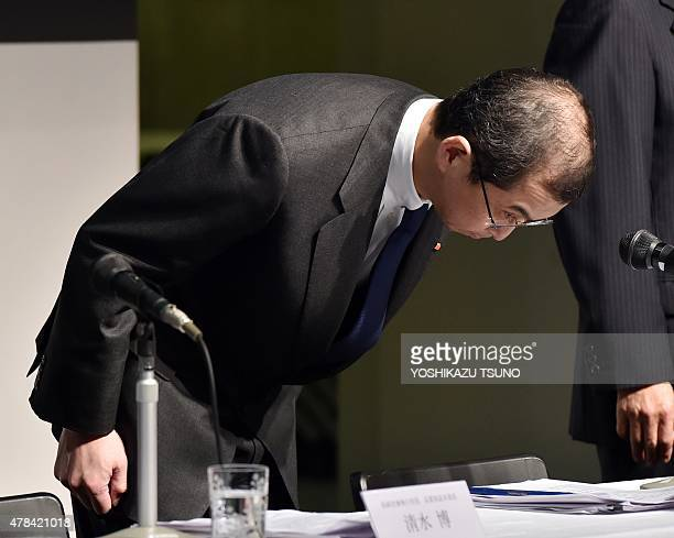 Japan's auto parts maker Takata chairman and president Shigehisa Takata bows in front of the media related to the global recall of the company's...