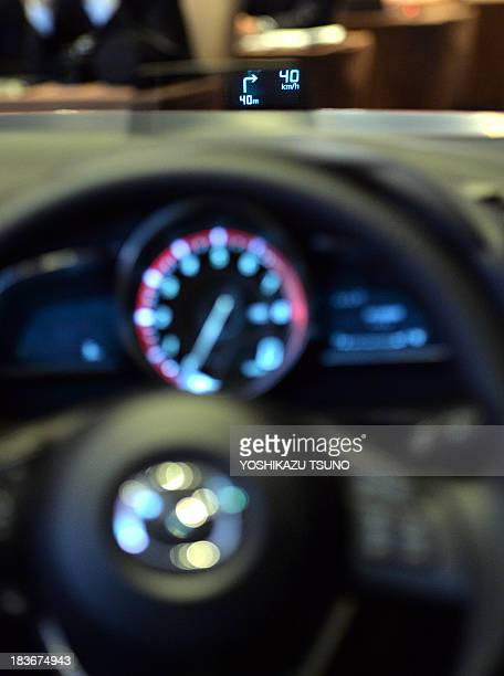 Japan's automaker Mazda displays the new information display technology 'active driving display' which shows driving information 15meters in front of...