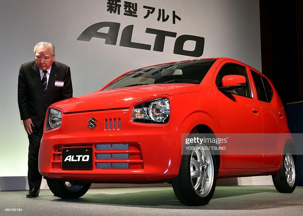 Japan's automaker Suzuki Motor president and chairman <a gi-track='captionPersonalityLinkClicked' href=/galleries/search?phrase=Osamu+Suzuki&family=editorial&specificpeople=580987 ng-click='$event.stopPropagation()'>Osamu Suzuki</a> displays the company's new wagon Alto in Tokyo on December 22, 2014. The new Alto has a 660cc economy efficiency engine getting 37 kilometres per litre. AFP PHOTO / Yoshikazu TSUNO