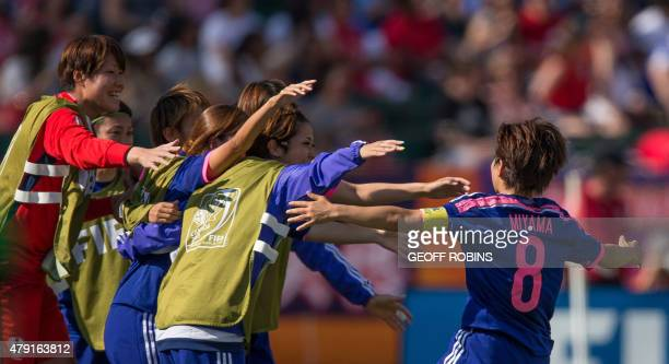 Japan's Aya Miyama celebrates her goal with teammates in the first half of their semifinal against England at the FIFA Women's World Cup in Edmonton...