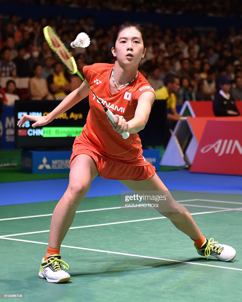 Japan s Aya Ohori returns a shot against China s He Bingjiao