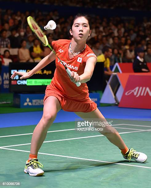 Japan's Aya Ohori returns a shot against China's He Bingjiao during their women's singles semifinal match at the Japan Open badminton tournament in...
