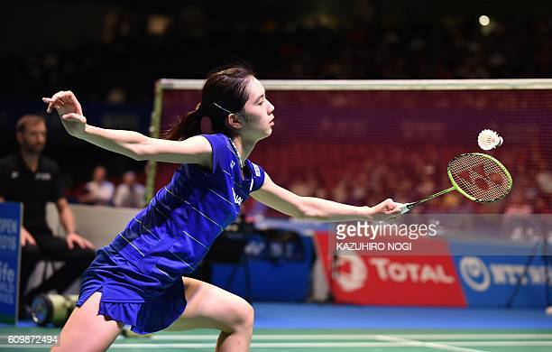 Japan's Aya Ohori returns a shot against her compatriot Mine Ayumi during their women's singles quarter final match at the Japan Open badminton...