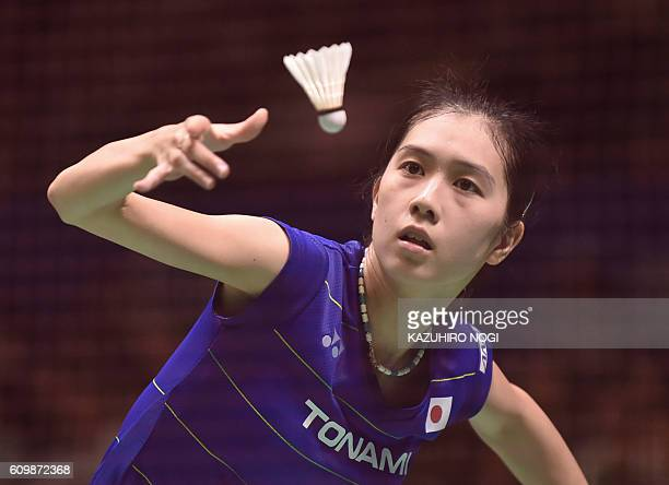 Japan's Aya Ohori serves against her compatriot Mine Ayumi during their women's singles quarter final match at the Japan Open badminton tournament in...