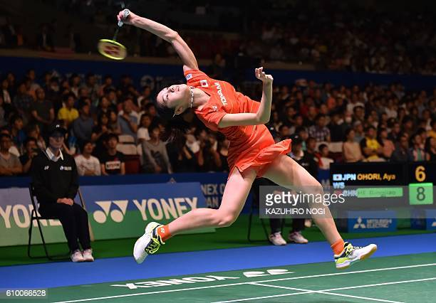 TOPSHOT Japan's Aya Ohori smashes a shot against China's He Bingjiao during their women's singles semifinal match at the Japan Open badminton...