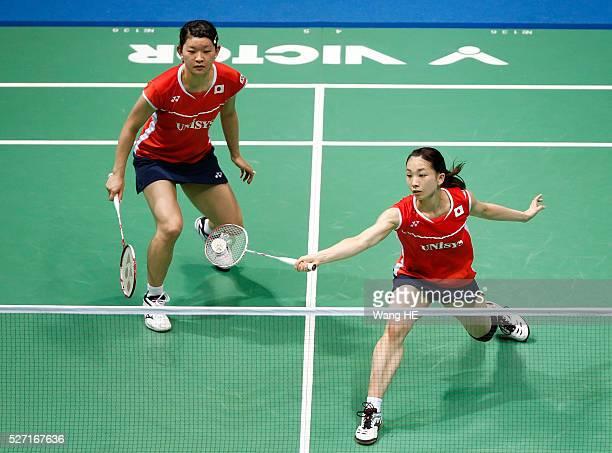 Japan's Ayaka Takahashi and Misaki Matsutomo hits a return during their women's doubles final match against Kurumi Yonao and Naoko Fukuman of Japan...