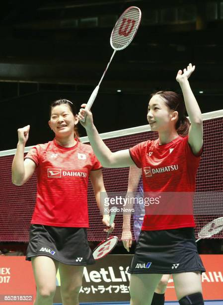 Japan's Ayaka Takahashi and Misaki Matsutomo who won the 2016 Rio de Janeiro Olympic women's badminton doubles celebrate after defeating South...