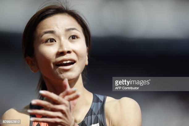 Japan's Ayako Kimura reacts to qualifying for the next round after competing in the women's 100m hurdles athletics event at the 2017 IAAF World...