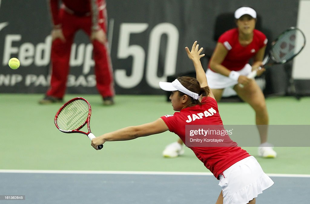 Japan's Ayumi Morita and Misaki Doi in action during their doubles match against Russia's Elena Vesnina and Ekaterina Makarova during day two of the Federation Cup 2013 World Group Quarterfinal match between Russia and Japan at Olympic Stadium on February 10, 2013 in Moscow, Russia.