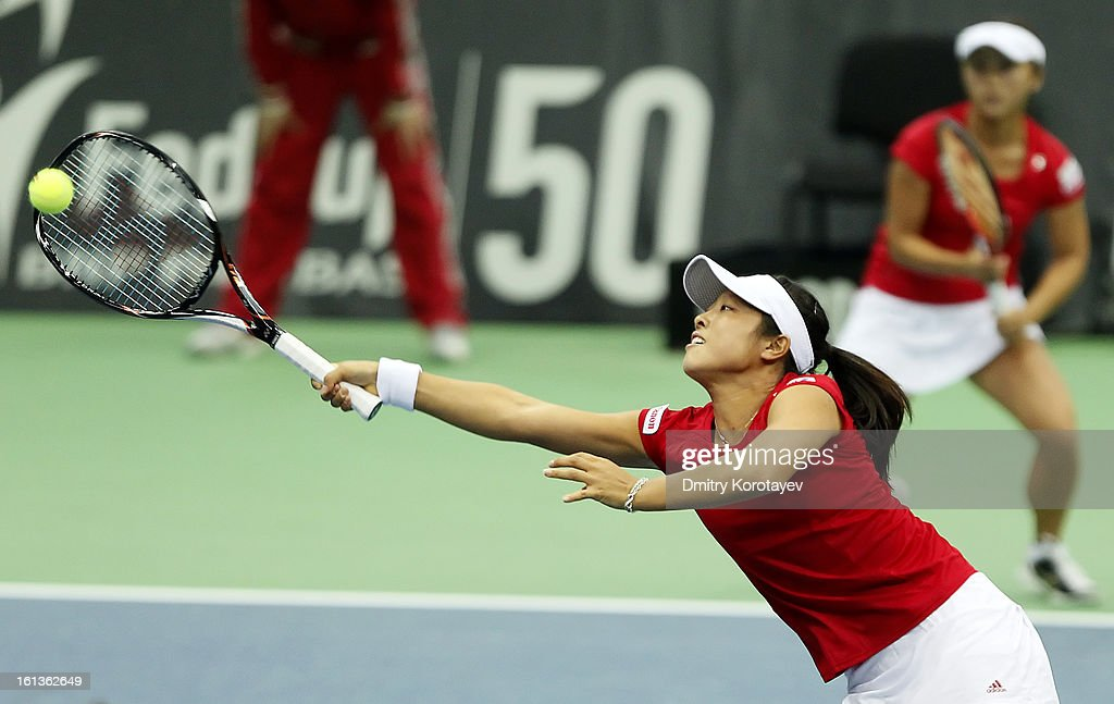 Japan's Ayumi Morita and Misaki Doi in action during their doubles match against Russia's Elena Vesnina and Ekaterina Makarova during day two of the Federation Cup 2013 World Group Quarterfinal match at Olympic Stadium on February 10, 2013 in Moscow, Russia.