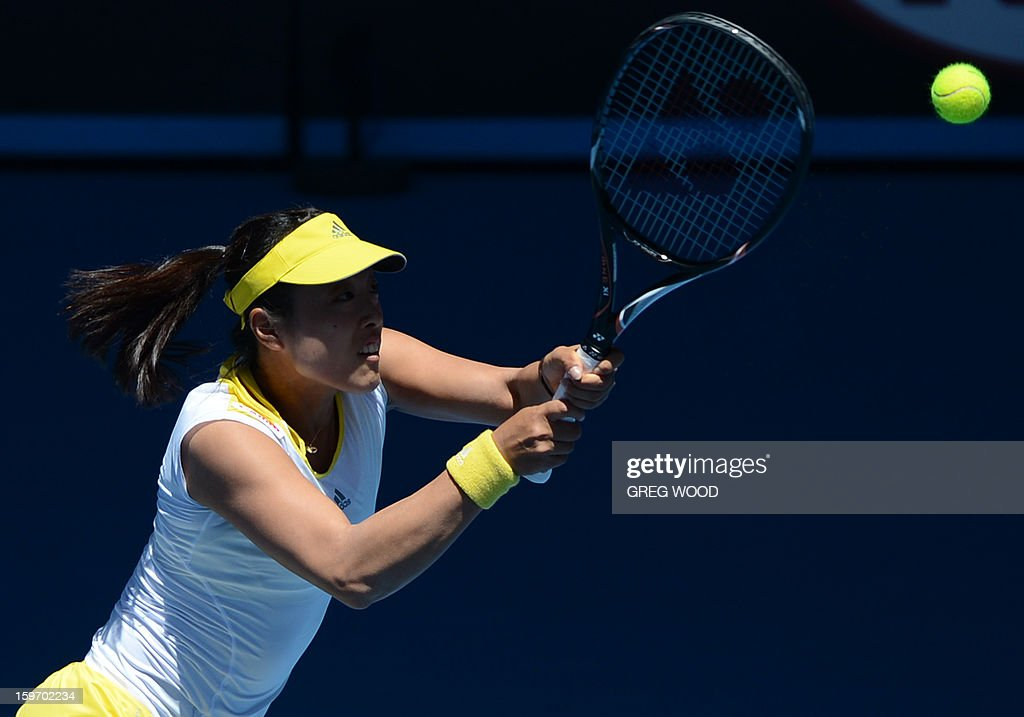 Japan's Ayumi Morita hits a return against Serena Williams of the US during their women's singles match on day six of the Australian Open tennis tournament in Melbourne on January 19, 2013. AFP PHOTO / GREG WOOD IMAGE STRICTLY RESTRICTED TO EDITORIAL USE - STRICTLY NO COMMERCIAL USE