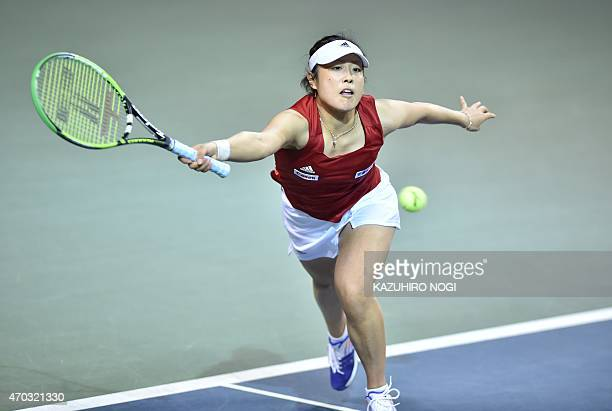 Japan's Ayumi Morita returns a shot against Aliaksandra Sasnovich of Belarus during their women's singles tennis match at the Fed Cup World Group II...