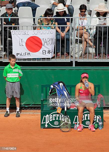 Japan's Ayumi Morita sits during a break as she plays against France's Kristina Mladenovic during their Women's first round match in the French Open...