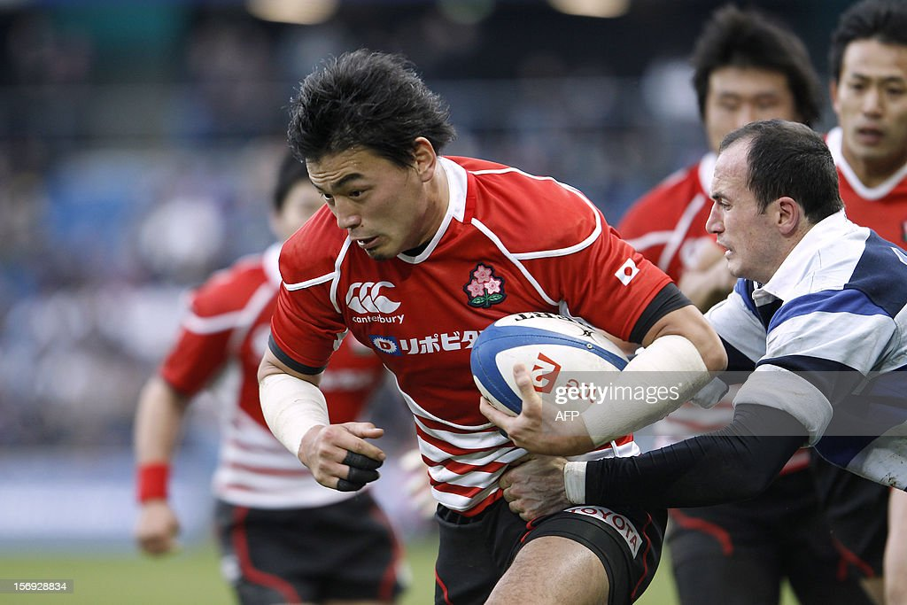 Japan's Ayumu Goromaru (C) makes a break during the Rugby Union exhibition match between Barbarian RC and Japan XV at Oceane Stadium, on November 25, 2012, in the northwestern city of Le Havre.