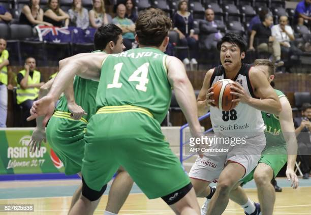 Japan's basketball team player Harimoto Tenketsu fights for the ball during a match against Australia in the FIBA AsiaCup 2017 in the Lebanese town...