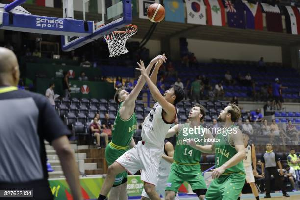 Japan's Basketball team player Takeuchi Kosuke fights for the ball with Australia's player Brandt Angus during the FIBA AsiaCup 2017 in the Lebanese...