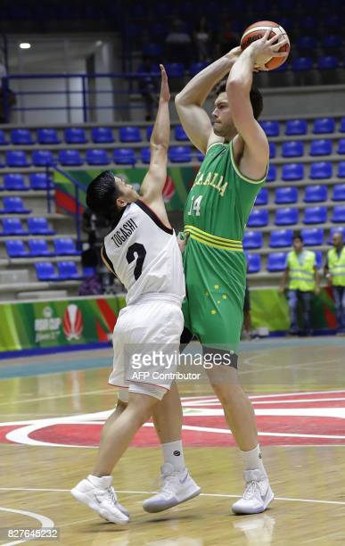 Japan's basketball team player Togashi Yuki tries to block Australia's Brandt Angus during a match in the FIBA AsiaCup 2017 in the Lebanese town of...