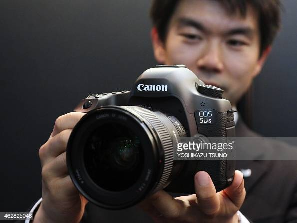 Japan 39 s camera giant canon unveils the new digital single for New camera 2015