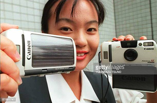 Japan's Canon Inc unveils the world's first solarpowered camera Autoboy SE 08 September in Tokyo Solar battery cells are mounted on its front cover...