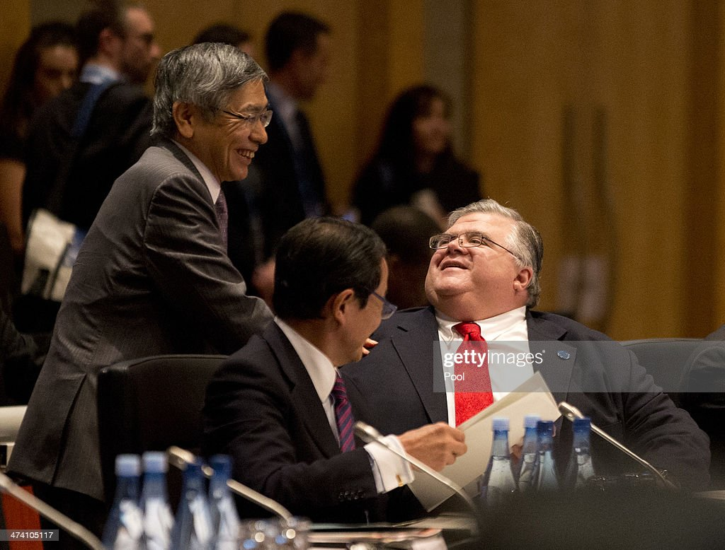 Japan's Central Bank Governor <a gi-track='captionPersonalityLinkClicked' href=/galleries/search?phrase=Haruhiko+Kuroda&family=editorial&specificpeople=649295 ng-click='$event.stopPropagation()'>Haruhiko Kuroda</a> (L) greets his Mexican counterpart <a gi-track='captionPersonalityLinkClicked' href=/galleries/search?phrase=Agustin+Carstens&family=editorial&specificpeople=2543899 ng-click='$event.stopPropagation()'>Agustin Carstens</a> as Japan's Minister of Finance <a gi-track='captionPersonalityLinkClicked' href=/galleries/search?phrase=Taro+Aso&family=editorial&specificpeople=559212 ng-click='$event.stopPropagation()'>Taro Aso</a> (C) watches on during the opening session of the the G20 Finance Ministers and Central Bank Governors round table meeting on February 22, 2014 in Sydney, Australia. This event is the first major G20 meeting under Australia's presidency in 2014.
