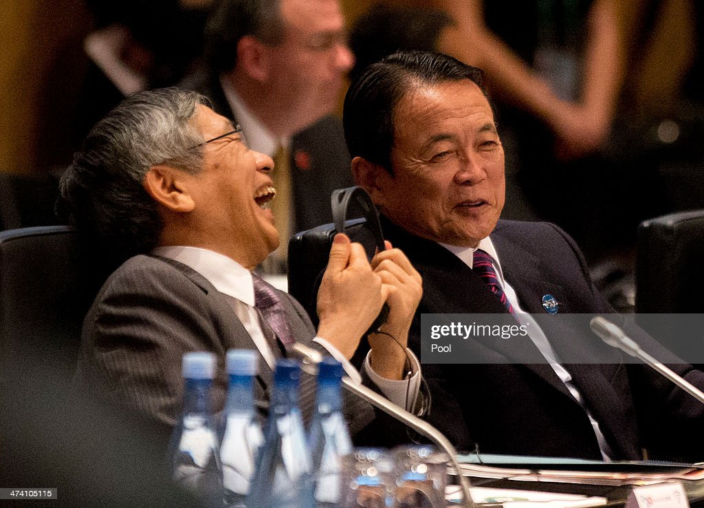 Japan's Central Bank Governor Haruhiko Kuroda (L) laughs alongside Japan's Minister of Finance Taro Aso during the opening session of the the G20 Finance Ministers and Central Bank Governors round table meeting on February 22, 2014 in Sydney, Australia. This event is the first major G20 meeting under Australia's presidency in 2014.