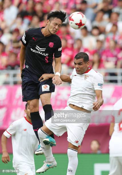 Japan's Cerezo Osaka forward Kenyu Sugimoto and Spain's Sevilla FC defender Gabriel Mercado fight for the ball during their friendly football match...