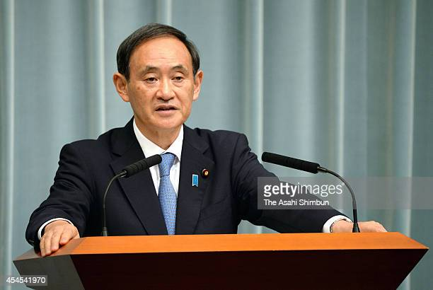 Japan's Chief Cabinet Secretary Yoshihide Suga announces the new cabinet members of Prime Minister Shinzo Abe at the prime minister's official...