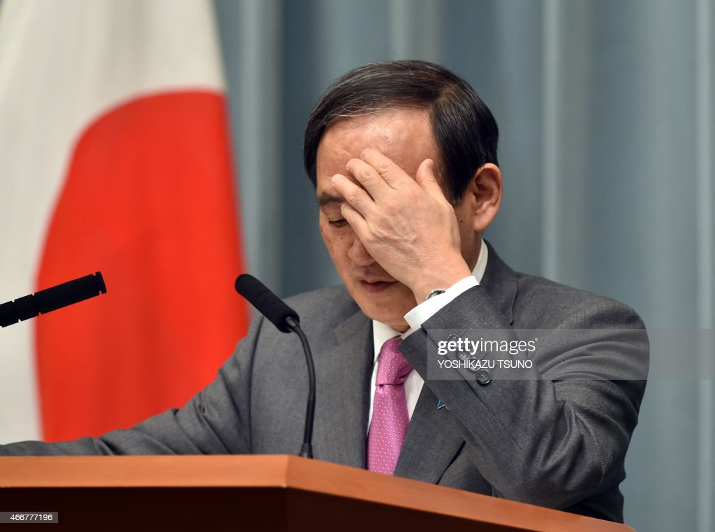 Japan's Chief Cabinet Secretary <a gi-track='captionPersonalityLinkClicked' href=/galleries/search?phrase=Yoshihide+Suga&family=editorial&specificpeople=3868279 ng-click='$event.stopPropagation()'>Yoshihide Suga</a> gestures as he answers a question at a press conference at the prime minister's official residence in Tokyo on March 19, 2015. Japan said at least three nationals were killed when gunmen stormed Tunisia's national museum, in what his government condemned as a 'despicable act of terrorism'. AFP PHOTO / Yoshikazu TSUNO