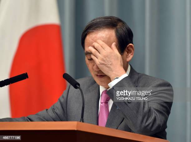 Japan's Chief Cabinet Secretary Yoshihide Suga gestures as he answers a question at a press conference at the prime minister's official residence in...