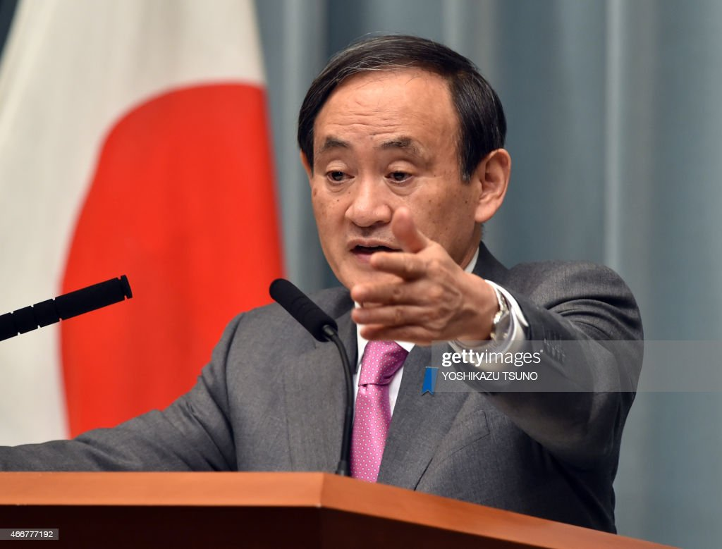 Japan's Chief Cabinet Secretary <a gi-track='captionPersonalityLinkClicked' href=/galleries/search?phrase=Yoshihide+Suga&family=editorial&specificpeople=3868279 ng-click='$event.stopPropagation()'>Yoshihide Suga</a> points to a journalist at a press conference at the prime minister's official residence in Tokyo on March 19, 2015. Japan said at least three nationals were killed when gunmen stormed Tunisia's national museum, in what his government condemned as a 'despicable act of terrorism'. AFP PHOTO / Yoshikazu TSUNO