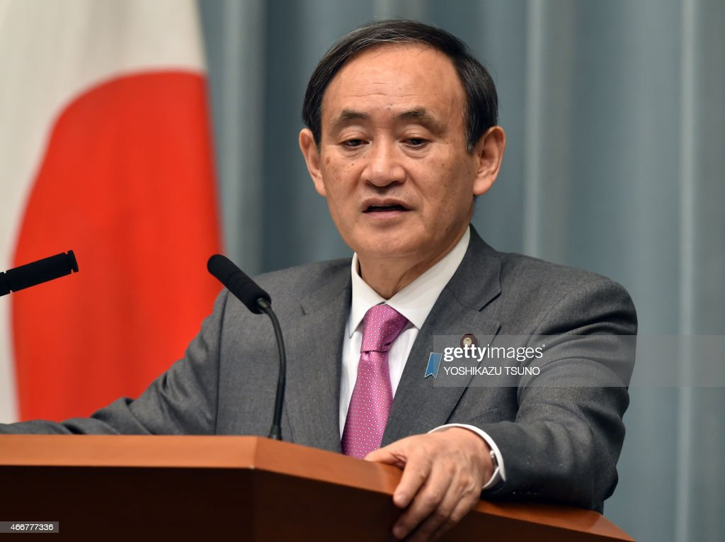 Japan's Chief Cabinet Secretary <a gi-track='captionPersonalityLinkClicked' href=/galleries/search?phrase=Yoshihide+Suga&family=editorial&specificpeople=3868279 ng-click='$event.stopPropagation()'>Yoshihide Suga</a> speaks at a press conference at the prime minister's official residence in Tokyo on March 19, 2015. Japan said at least three nationals were killed when gunmen stormed Tunisia's national museum, in what his government condemned as a 'despicable act of terrorism'. AFP PHOTO / Yoshikazu TSUNO