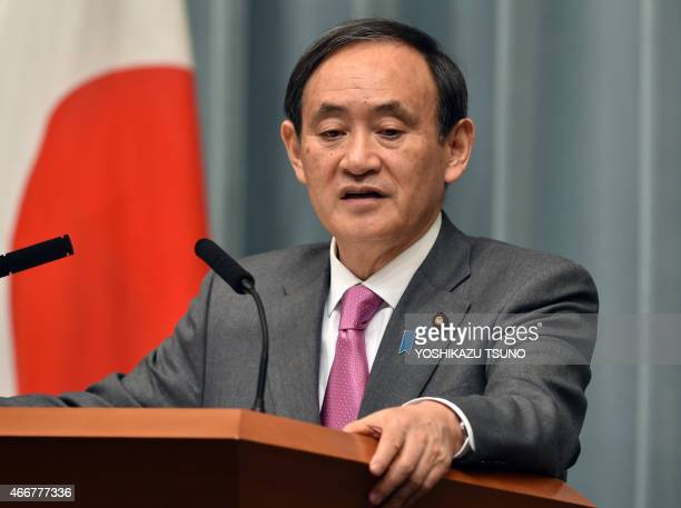Japan's Chief Cabinet Secretary Yoshihide Suga speaks at a press conference at the prime minister's official residence in Tokyo on March 19 2015...