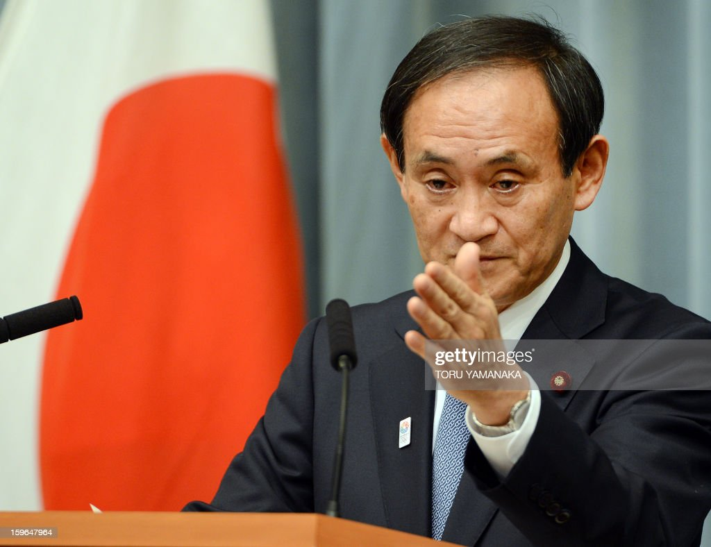 Japan's Chief Cabinet Secretary Yoshihide Suga urges questions during a press conference after a cabinet-level meeting to co-ordinate its response to hostage issues in Algeria at the prime minister's official residence in Tokyo on January 18, 2013. Japanese plant builder JGC said on January 18 it had confirmed the safety of three of its Japanese staff and one Philippine employee in Algeria, with the whereabouts of 74 other staff of various nationalities unknown. AFP PHOTO/Toru YAMANAKA