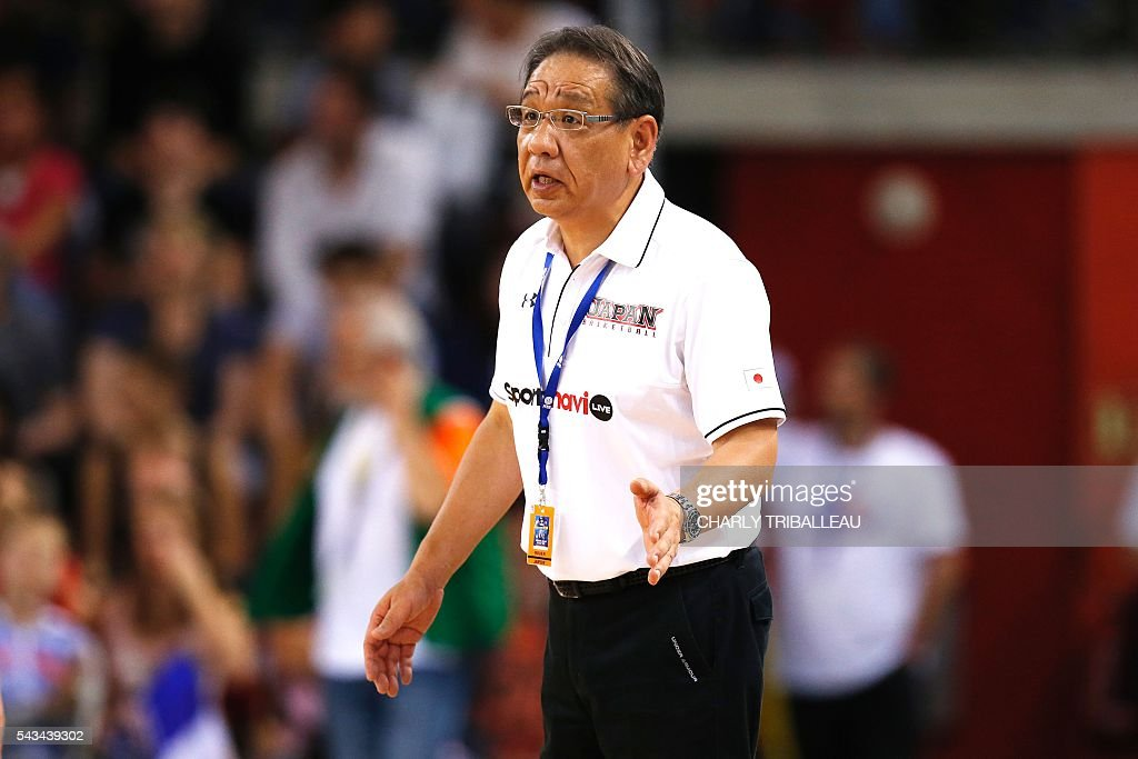 Japan's coach Kenji Hasegawa reacts during the basketball match between France and Japan at the Kindarena hall in Rouen on June 28, 2016. / AFP / CHARLY
