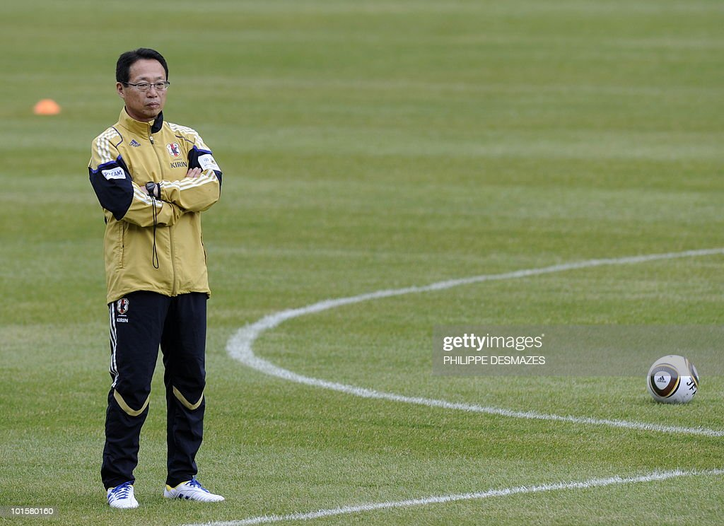 Japan's coach Takeshi Okada looks at his players training during a practice session on May 26, 2010 in the Swiss Alpine resort of Saas-Fee ahead of the FIFA World Cup 2010 finals in South Africa.