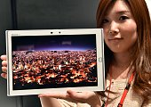 Japan's computer giant Fujitsu employee displays the world's lightest 10inch sized tablet 'Arrows Tab F03G' weighing 433g with a waterproof body in...