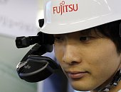 Japan's computer giant Fujitsu engineer displays a head mount display for factory work 'Ubiquitouswear' equipped with a 04inch singleeye display to...