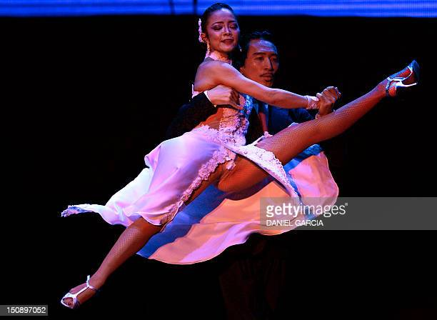 Japan's couple Genta Nakazawa and Manabu Kato perform during the final competition of Stage Tango on August 28 2012 at the World Championship of...