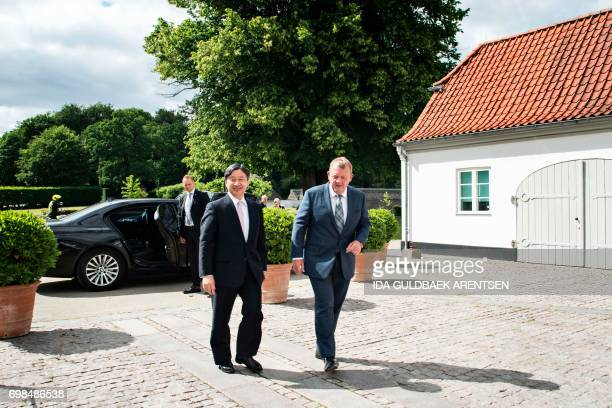 Japan's Crown Prince Nahurito arrives at the Danish Prime Minister Lars Loekke Rasmussen's home in Marienborg north of Copenhagen on June 20 2017...