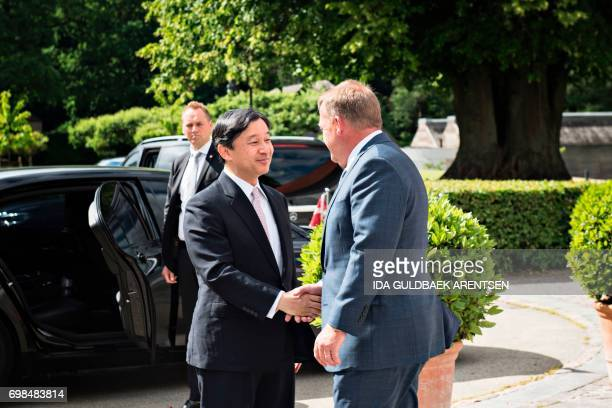 CORRECTION Japan's Crown Prince Nahurito shakes hands with Danish Prime Minister Lars Loekke Rasmussen as he arrives at the Prime Minister' home in...