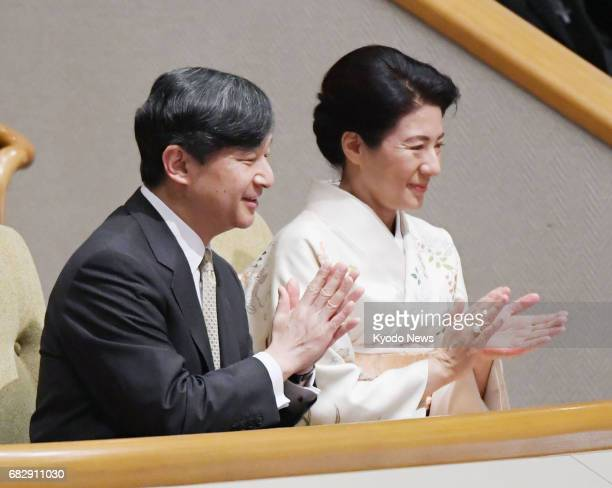 Japan's Crown Prince Naruhito and Crown Princess Masako applaud while watching the Summer Grand Sumo Tournament at Tokyo's Ryogoku Kokugikan on May...