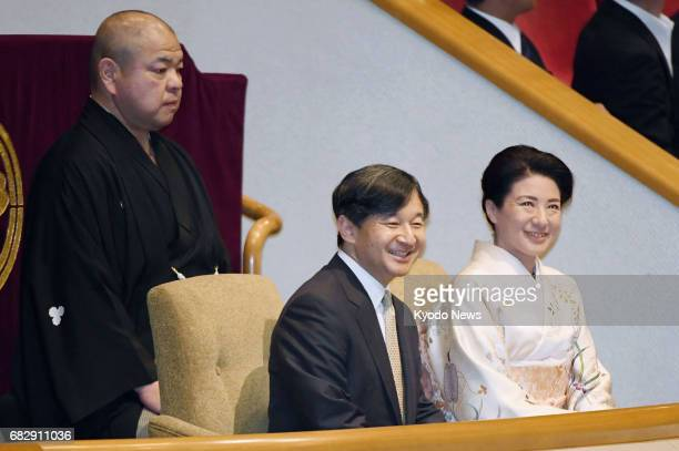 Japan's Crown Prince Naruhito and Crown Princess Masako watch the Summer Grand Sumo Tournament at Tokyo's Ryogoku Kokugikan on May 14 the opening day...