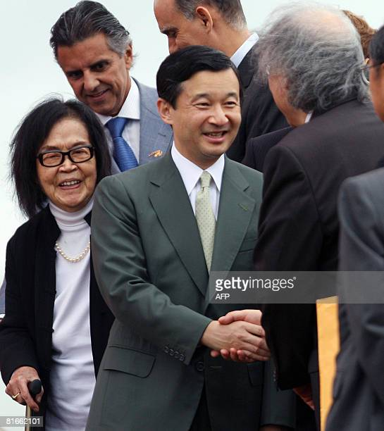Japan's Crown Prince Naruhito shakes hands with architect Ruy Ohtake son of artist Tomie Ohtake during a ceremony at the monument commemorating...