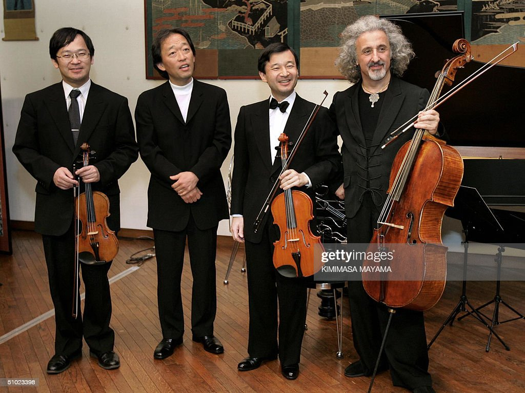 japans-crown-prince-naruhito-smiles-with-japanese-violinist-eiji-arai-picture-id51023398