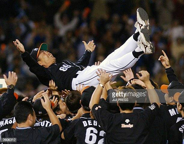 Japan's Daiei Hawks manager Sadaharu Oh is tossed in the air by players as the Hawks clinched their first Pacific League pennant in three years 30...