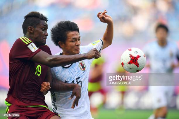 Japan's Daiki Sugioka fights for the ball with Venezuela's Sergio Cordova during their U20 World Cup round of 16 football match between Venezuela and...